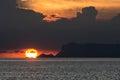 OMEGA SUNSET AT THE SEASIDE Royalty Free Stock Photo