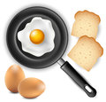 Omelet in frying pan with bread and egg
