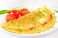 Omelet with herbs and vegetables close up view Stock Image