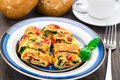 Omelet with vegetables and herbs on a plate Stock Photos