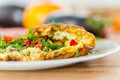 Omelet with vegetables and tomatoes on a plate Stock Photography