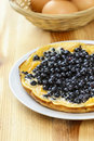 Omelette with blueberries on wooden table healthy food Stock Images