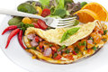 Omelette home made omelet with cheese and salad close up with focus on the omelet Royalty Free Stock Image