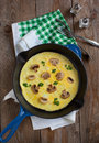 Omelette with mushroom in a pan Royalty Free Stock Images