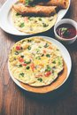 Omelette / omelette chapati roll or Indian bread or roti rolled with omlet. Royalty Free Stock Photo