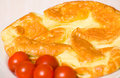 Omelette with tomato on a white plate Royalty Free Stock Images