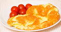 Omelette with tomato on a white plate Stock Images