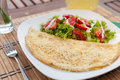 Omelette with vegetable salad on an wood table lemonade Royalty Free Stock Photos