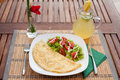 Omelette with vegetable salad on an wood table lemonade Royalty Free Stock Images
