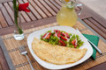 Omelette with vegetable salad on an wood table lemonade Stock Photo