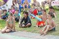 Omer - Beer-Sheva, ISRAEL -Children on the grass watching the summer poolside view, July 25, 2015 Royalty Free Stock Photo