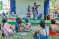 Omer (Beer-Sheva), ISRAEL -Two clowns on stage near the pool in front of children, seen from behind, July 25, 2015 Royalty Free Stock Photo