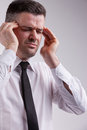 Omg what a headache says the man woith severe suffering Stock Photos