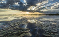 Ominous stormy sky reflection over natural lake in the danube delta Stock Photo