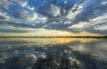 Ominous stormy sky reflection over natural lake in the danube delta Royalty Free Stock Images
