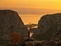 Omis croatia dalmatia aerial view of the old town of in a orange sunset and the place where the river cetina flows into the Royalty Free Stock Images