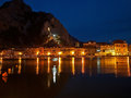 Omis at night croatia old town the reflection of the city and city lights in the river cetina horizontal color photo Stock Photos