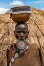 Omo valley people mursi woman with lip plate ethiopia march the are a nilotic pastoralist ethnic group that inhabits southwestern Royalty Free Stock Photography