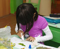 Omsk, Russia - September 24, 2011: schoolgirl glues applique at school desk Royalty Free Stock Photo