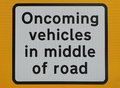 Title: Oncoming vehicles sign