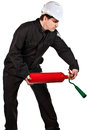 One adult male handyman professional technician repairman wearing black coveralls uniform white hardhat holding red extinguisher Royalty Free Stock Photo