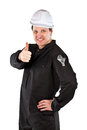 One adult male handyman professional technician repairman wearing black coveralls uniform white hardhat spanner too showing thumb Stock Photography