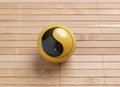 One baoding ball on bamboo background in horizontal composition Royalty Free Stock Photo