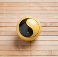One baoding ball on bamboo background in square composition Stock Photos