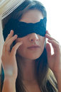 One beautiful glamour young woman with black band of lace on the face blindfold