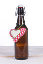 One beer bottle with heart on wooden ground Royalty Free Stock Photo