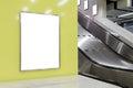 One big vertical portrait orientation blank billboard on modern yellow wall with escalator background Stock Photography
