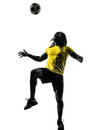 One black brazilian soccer football player man silhouette in studio on white background Royalty Free Stock Photo