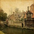 One of bruges canals near church our lady belgium photo in retro style paper texture Royalty Free Stock Image
