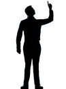 One business man pointing up happy silhouette caucasian standing full length in studio isolated on white background Stock Photo