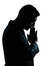 One business man thinking praying silhouette Stock Images