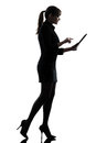 One business woman walk g computer computing typing digital tablet silhouette studio white background Royalty Free Stock Photos