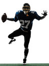 Triumphant american football player man silhouette Royalty Free Stock Photo