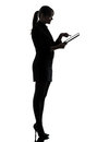 One caucasian business woman computer computing typing digital tablet silhouette studio white background Stock Photos