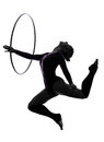 One caucasian woman exercising rhythmic gymnastics hula hoop silhouette studio isolated white background Royalty Free Stock Photo