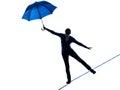 Woman holding umbrella silhouette Royalty Free Stock Photo
