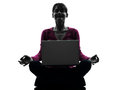 One caucasian woman lotus posture computing laptop computer silhouette studio white background Royalty Free Stock Photos