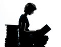 One caucasian young teenager silhouette girl reading full length in studio cut out isolated on white background Royalty Free Stock Image