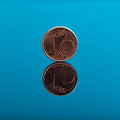One cent, Euro money coin on blue with reflection Royalty Free Stock Photo