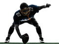 One center american football player man silhouette studio white background Stock Photos