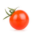 One cherry tomato on a white background