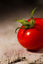 One chryy tomatoe on wooden background Royalty Free Stock Image