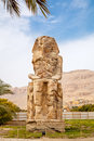 One of colossi of memnon luxor west bank egypt Stock Photos
