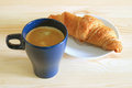 One Cup of Coffee with a Butter Croissant Royalty Free Stock Photo