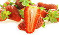 One cut fresh ripe strawberry Royalty Free Stock Image