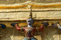 One demon and golden stupa yaksha is holding in the temple of emerald buddha Royalty Free Stock Images